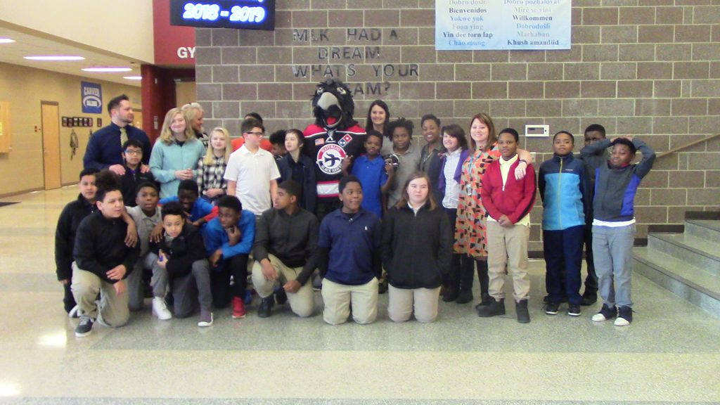 Group picture of students with Tommy Hawk