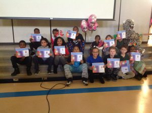 14 students holding certificates smiling with Linc